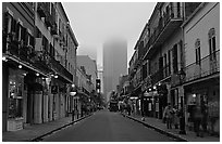 Bourbon street and the new town in the fog, French Quarter. New Orleans, Louisiana, USA ( black and white)