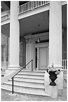 Entrance stairs, door, and columns, Magnolia Hall. Natchez, Mississippi, USA (black and white)