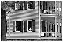 House with lamp inside window. Columbia, South Carolina, USA ( black and white)
