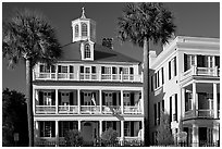 Antebellum house with flag and octogonal tower. Charleston, South Carolina, USA (black and white)