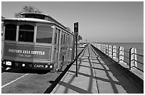 Waterfront promenade with shuttle bus. Charleston, South Carolina, USA (black and white)