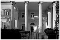 Greek revival facade with weathered  pilars. Charleston, South Carolina, USA (black and white)