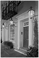 House facade with gas lamps. Charleston, South Carolina, USA ( black and white)