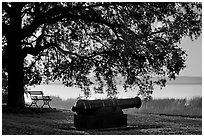 Cannon, and bench overlooking Beaufort Bay at sunrise. Beaufort, South Carolina, USA ( black and white)