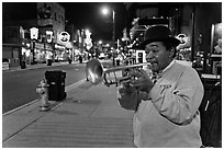 Jazz Street Musician on Beale Street by night. Memphis, Tennessee, USA (black and white)