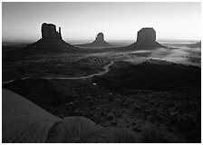 Mittens, sunrise. Monument Valley Tribal Park, Navajo Nation, Arizona and Utah, USA (black and white)