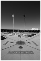 Disks, seals, and flags. Four Corners Monument, Arizona, USA ( black and white)