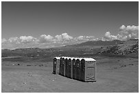 Portable toilets in desert. Four Corners Monument, Arizona, USA ( black and white)