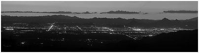 Tucson lights at sunset from Rincon Mountains. Tucson, Arizona, USA (Panoramic black and white)