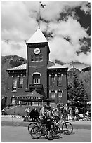 Mountain bikers in front of San Miguel County court house. Telluride, Colorado, USA (black and white)