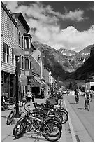 Mountain bikes parked on main street sidewalk. Telluride, Colorado, USA (black and white)