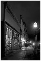 Coffee shop and sidewalk by night. Telluride, Colorado, USA ( black and white)