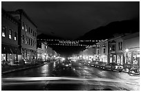 Colorado Street by night with Mountainfilm banner. Telluride, Colorado, USA ( black and white)