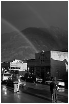 People watching double rainbow on main street. Telluride, Colorado, USA ( black and white)