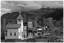Western-style buildings and horses, Ridgeway. Colorado, USA ( black and white)