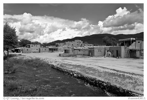 Rio Pueblo stream and pueblo village. Taos, New Mexico, USA