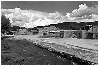 Rio Pueblo stream and pueblo village. Taos, New Mexico, USA (black and white)