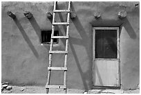 Ladder on adobe facade. Taos, New Mexico, USA (black and white)
