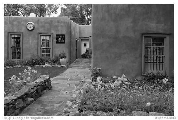 Front yard and pueblo style houses. Taos, New Mexico, USA (black and white)