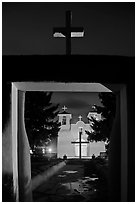 San Francisco de Asisis mission from entrance gate at night, Rancho de Taos. Taos, New Mexico, USA (black and white)