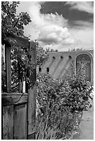Gardens and adobe wall, Sanctuario de Chimayo. New Mexico, USA (black and white)