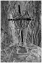 Metal cross festoned with rosaries, and crosses made of twigs, Sanctuario de Chimayo. New Mexico, USA ( black and white)