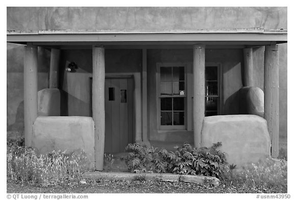 Blue and adobe house porch. Santa Fe, New Mexico, USA (black and white)