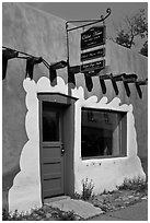 Door, window, and sign indicating oldest house. Santa Fe, New Mexico, USA ( black and white)