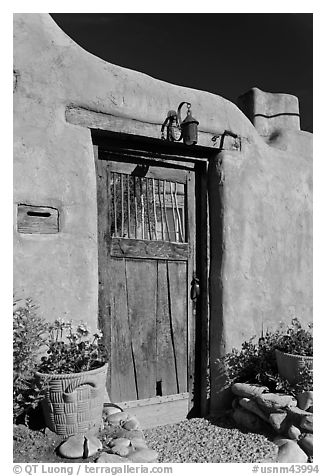 Wooden door and adobe wall. Santa Fe, New Mexico, USA