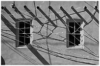 Detail of art installation on facade of adobe building. Santa Fe, New Mexico, USA (black and white)