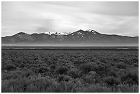 Sagebrush plateau incised by Rio Grande Gorge and Sangre De Cristo Mountains. Rio Grande Del Norte National Monument, New Mexico, USA ( black and white)
