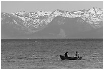 Canoe and snowy mountains, Lake Tahoe, Nevada. USA ( black and white)