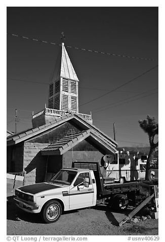 Truck and house with bell-tower, Beatty. Nevada, USA