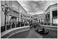 Gondolas and Grand Canal bordered by shops in the Venetian casino. Las Vegas, Nevada, USA (black and white)