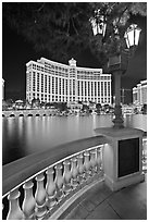 Lamp, reflection lake, and Bellagio hotel at night. Las Vegas, Nevada, USA (black and white)