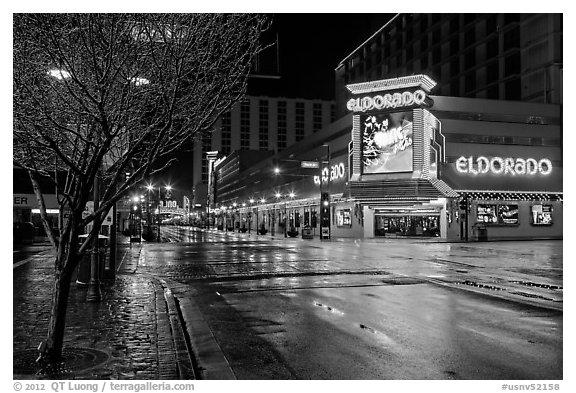 Main street with night reflections on wet pavement. Reno, Nevada, USA