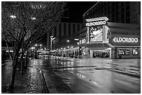 Main street with night reflections on wet pavement. Reno, Nevada, USA (black and white)