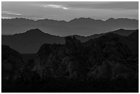 Whitney Pocket rocks and mountain ranges at sunset. Gold Butte National Monument, Nevada, USA ( black and white)