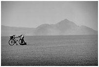 Bicyclist on the desert Playa, Black Rock Desert. Nevada, USA ( black and white)