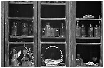 Old bottles in a store window, Austin. Nevada, USA ( black and white)