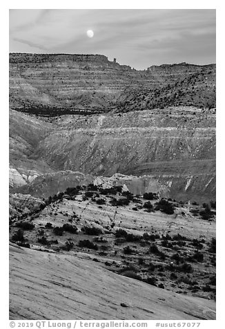 Moon rising over colorful rocks of the Cockscomb. Grand Staircase Escalante National Monument, Utah, USA (black and white)