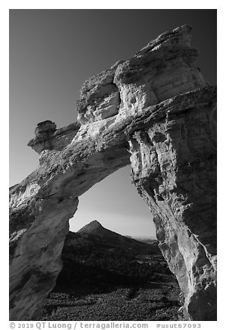 Grosvenor Arch framing peak. Grand Staircase Escalante National Monument, Utah, USA (black and white)