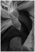 Sculpted sandstone walls and small arch, Peek-a-Boo slot canyon. Grand Staircase Escalante National Monument, Utah, USA ( black and white)