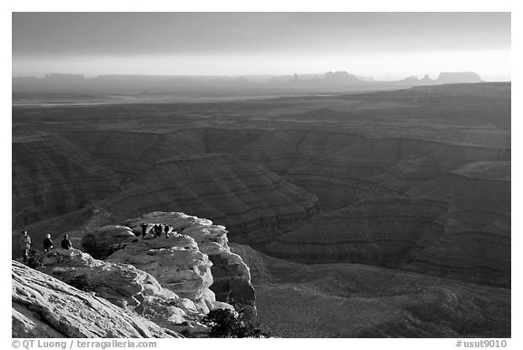Watching the sunset over the San Juan River, Monument Valley in the background. Utah, USA (black and white)