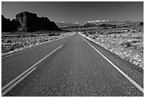 Road, sandstone cliffs, snowy mountains. Utah, USA (black and white)
