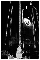 Child with christmas hat in front of St Joseph Cathedral on Christmas eve. Ho Chi Minh City, Vietnam ( black and white)
