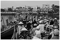 Crowd crossing the mobile bridge, Duong Dong. Phu Quoc Island, Vietnam (black and white)