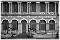 Facade of courthouse with blue doors and windows. Ho Chi Minh City, Vietnam ( black and white)
