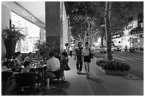 Street with luxury stores at night. Ho Chi Minh City, Vietnam ( black and white)