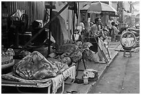 Vendors sleeping on the street at dawn. Ho Chi Minh City, Vietnam (black and white)